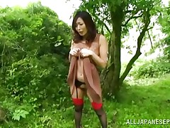 Nature loving Nippon cutie is receiving her dose of wilderness! This cute bitch has her hands tied on a tree branch and gets roughly fucked from behind. Her moans and screams won't help her because there's nobody around. Look at that sweet cum-hole being rubbed with a sextoy and then drilled hard.