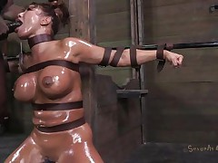 Milf Ava is bound in leather belts and her sexy body has been oiled up. This babe patiently awaits down on her knees for smth to happen when the executor comes at her and pays this bitch some attention. This chab grabs her by the hair and begins to mouth fuck her deep, reminding Ava where's her place